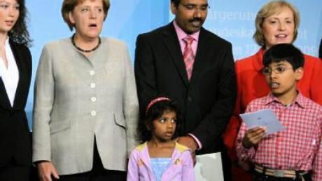 Merkel ruft Ausländer zur Einbürgerung auf