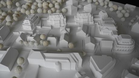 So sollen die Löwenbräu-Arkaden auf dem Löwenbräu-Areal und der Luerswiese platziert werden. Es handelt sich um die Gebäude mit ausgestalteter Fassade; im Hintergrund zu sehen ist der Kurpark.