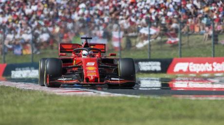 Sebastian Vettel und Co. werden 2020 insgesamt 22 Rennen fahren. Foto: Zoltan Balogh/MTI/AP