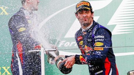Fuhren einst bei Red Bull erfolgreich zusammen: Sebastian Vettel (l) und Mark Webber.