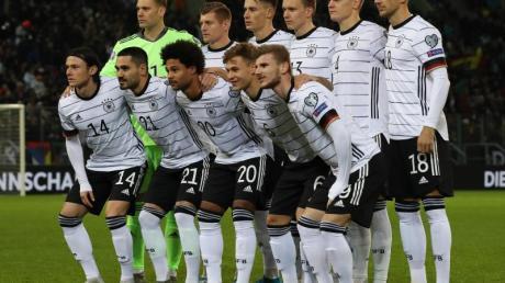 Das DFB-Team hat sich zum 13. Mal für eine Fußball-EM qualifiziert: Turnierrekord. Foto: Christian Charisius/dpa