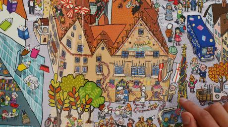"""Wo ist er denn, der Einstein? Auf den Wimmelbildern in """"Ulm wimmelt"""" von Steph Burlefinger gibt es neben turbulenten Szenen auch einige bekannte Ulmer Figuren zu entdecken."""