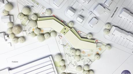 Im Bild ist der erste Entwurf des Kindergartens zu sehen. Der ganze Komplex wurde inzwischen etwas weiter Richtung Nordwesten gerückt. Im linken Bereich wird das Gebäude um zwei Krippengruppen erweitert.