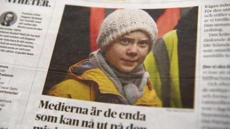"""Ein Foto von Klima-Aktivistin Greta Thunberg ziert eine Seite der schwedischen Tageszeitung """"Dagens Nyheter""""."""