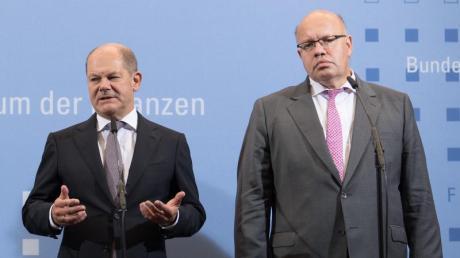 Finanzminister Olaf Scholz (l) erteilt den Plänenvon Wirtschaftsminister Peter Altmaier eine Absage.