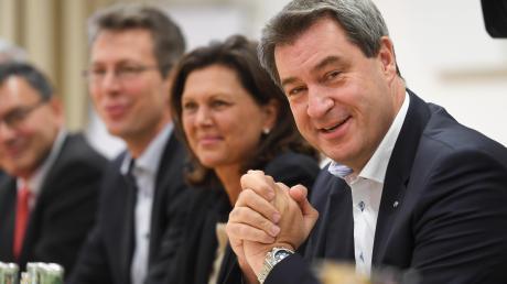 Markus Söder (rechts) und seine CSU basteln an einer neuen Regierung.
