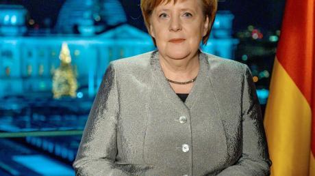In der Ansprache fordert Merkel auf, Verantwortung zu übernehmen.