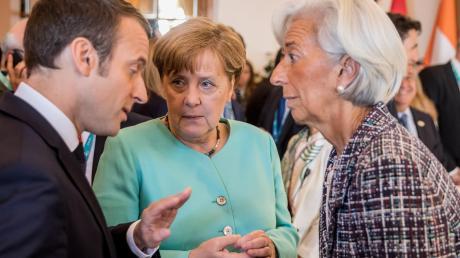 Frankreichs Präsident Emmanuel Macron mit Bundeskanzlerin Angela Merkel (Mitte) und der künftigen EZB-Chefin Christine Lagarde.