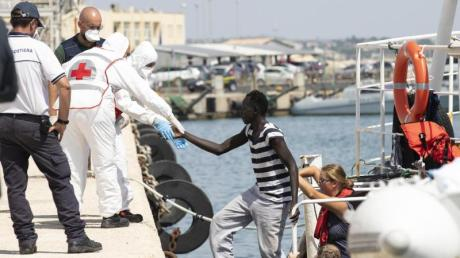 Deutschland will jeden vierten Bootsflüchtling aus Italien aufnehmen.