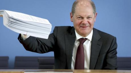 Bundesfinanzminister Olaf Scholz während der Pressekonferenz zum Hilfspaket der Bundesregierung.