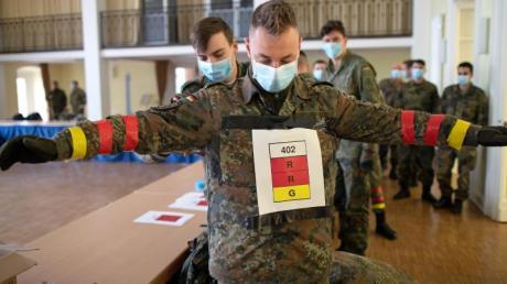 Soldaten der Bundeswehr in Berlin testen derzeit eine Covid19-Tracking App.