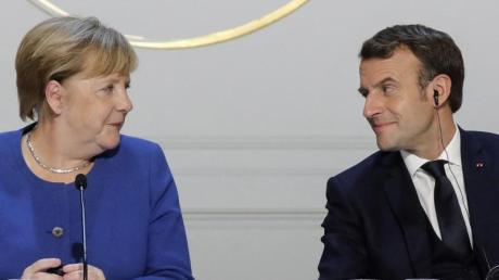 Angela Merkel und Emmanuel Macron starteten eine gemeinsame Initiative für den Wiederaufbau in Europa - die «Sparsamen Vier» Österreich, Schweden, Dänemark und die Niederlande gehen auf Konfrontationskurs (Archiv).