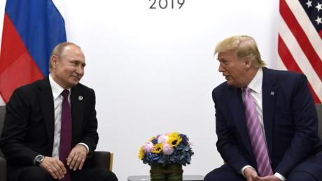 US-Präsident Donald Trump (r) und Russlands Präsident Wladimir Putin.