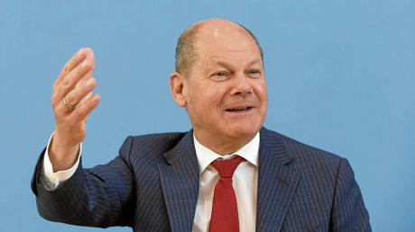 """Bundesfinanzminister Olaf Scholz: """"Jetzt wird wieder in die Hände gespuckt, wir steigern das Bruttosozialprodukt."""""""