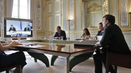Frankreichs Präsident Emmanuel Macron konferiert mit Serbiens Präsident Vucic, dem kosovarischen Ministerpräsident Hoti und EU-Politikern.