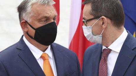 Die Premierminister von Ungarn und Polen: Viktor Orban und Mateusz Morawiecki. Beide Länder seien nun bereit, ihre Blockade des EU-Haushalts aufzugeben.