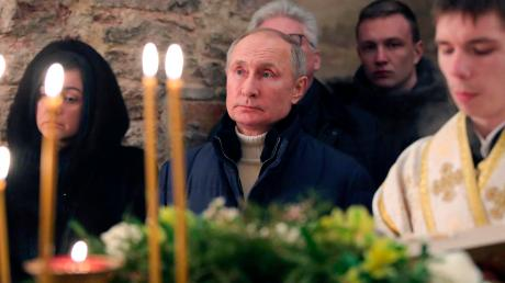 Wladimir Putin bei einer orthodoxen Weihnachtsmesse. Moskau belehrt Washington in Fragen demokratischer Standards.