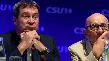 Die Ermittlungen gegen den Landtagsabgeordneten Alfred Sauter (rechts) werden auch für CSU-Chef Markus Söder (links) zum unkalkulierbaren Risiko.