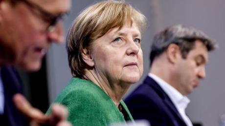 15 Stunden haben Kanzlerin Angela Merkel und die Ministerpräsidenten getagt, ehe sie einen Kompromiss verkünden konnten.