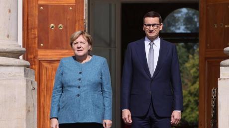 Merkel verabschiedet sich von Polens Premier Mateusz Morawiecki.