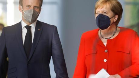 Bundeskanzlerin Angela Merkel und Frankreichs Präsident Emmanuel Macron zusammen in Berlin.