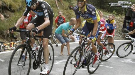 Chris Froome (l) und Alberto Contador haben beste Aussichten auf das Gelbe Trikot.