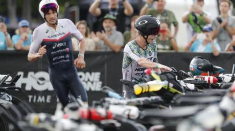 Die Ironman-WM auf Hawaii könnte verschoben werden: Josh Amberger (r) aus Australien und Jan Frodeno aus Deutschland.