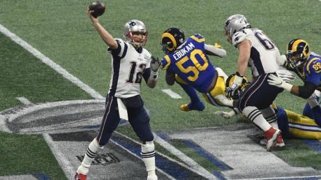 Quarterback Tom Brady (l) und die New England Patriots dominieren die NFL. Foto: XinHua