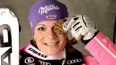 Wohl die letzte deutsche Kombinations-Weltmeisterin: Maria Höfl-Riesch posiert bei der WM 2013 in Schladming mit ihrer Goldmedaille.