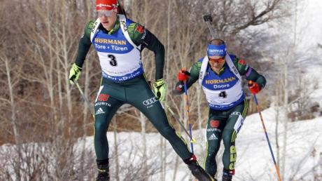 Die deutschen Biathleten Roman Rees (l) und Erik Lesser (r).