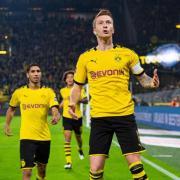 BVB-Kapitän Marco Reus (M) erzielte dem Dortmunder Siegtreffer. Foto: Guido Kirchner/dpa