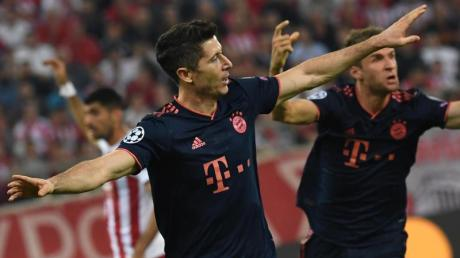 Matchwinner in Piräus: Doppeltorschütze Robert Lewandowski (l) und Thomas Müller. Foto: Sven Hoppe/dpa