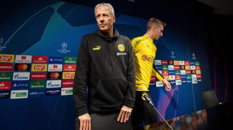 Sind mit dem BVB beim FCBarcelona gefordert: Coach Lucien Favre (l) und Kapitän Marco Reus.