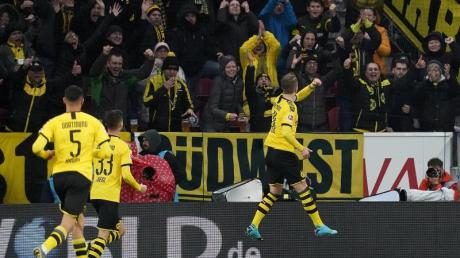 Die Dortmunder um Marco Reus (r) sind heiß auf RB Leipzig.