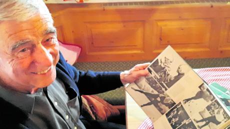 Der Spaß kommt beim Schmökern: Erhard Keller hat in einem Olympia-Buch aus dem Jahr 1968 ein Foto von seinem Erfolg über 500 Meter entdeckt.