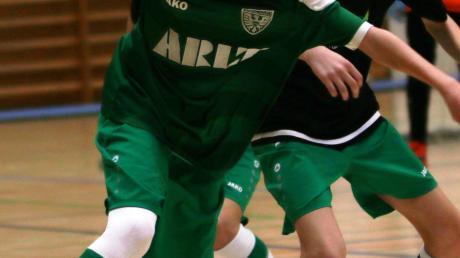 Jan Lenz von der Mannschaft TSV Nördlingen grün in Aktion,