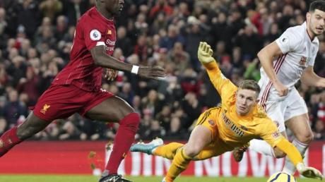 Liverpools Sadio Mané (l) erzielte das 2:0 gegen Sheffield United.