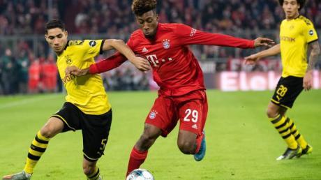 Achraf Hakimi (l) im Zweikampf mit Bayern-Profi Kingsley Coman.