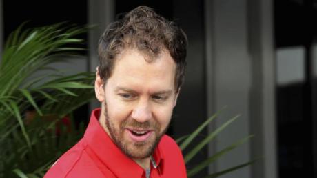 Freut sich über seinen neuen Dienstwagen:Ferrari-Pilot Sebastian Vettel.