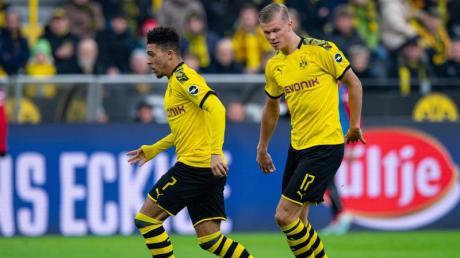 Dortmunds Jadon Sancho (L) und Erling Haaland treffen im Champions-League-Achtelfinale auf Paris Saint Germain.