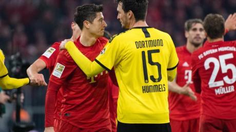 Die Spitzenspiele zwischen Bayern und Dortmund werden auch künftig meistens auf Sky zu sehen sein.