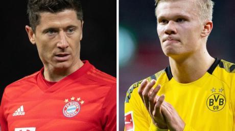 Bayern Münchens Robert Lewandowski (l) und Erling Haaland von Borussia Dortmund treffen am Dienstag aufeinander.