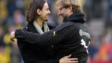 Wünscht sich, dass Jürgen Klopp (r) einmal Bundestrainer wird: Neven Subotic (l).