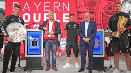 Am Sonntagnachmittag lachten die Dauergewinner des FC Bayern nach einer kurzen Nacht im Münchner Rathaus.