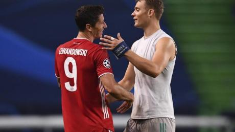 Holten mit Bayern das Triple: Torjäger Robert Lewandowski (l) und Torhüter Manuel Neuer.