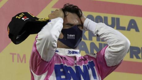 Sergio Perez feiert seinen ersten Grand-Prix-Sieg.