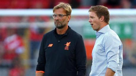 Noch ist unklar, wann RB-Coach Julian Nagelsmann (r) den FC Liverpool mit Jürgen Klopp in Leipzig empfangen kann.