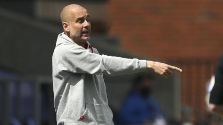 Erwartet gegen Paris Saint-Germain ein hartes Spiel: Pep Guardiola, Trainer von Manchester City.