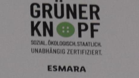 """Der """"Grüne Knopf"""" ist das staatliche Siegel für nachhaltige Kleidung."""