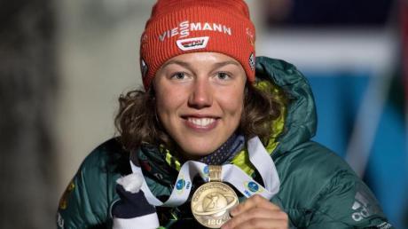 Biathlon-Star Laura Dahlmeier hat überraschend die sportliche Karriere beendet.